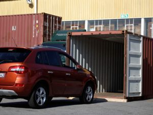 car and container for a vehicle transfer