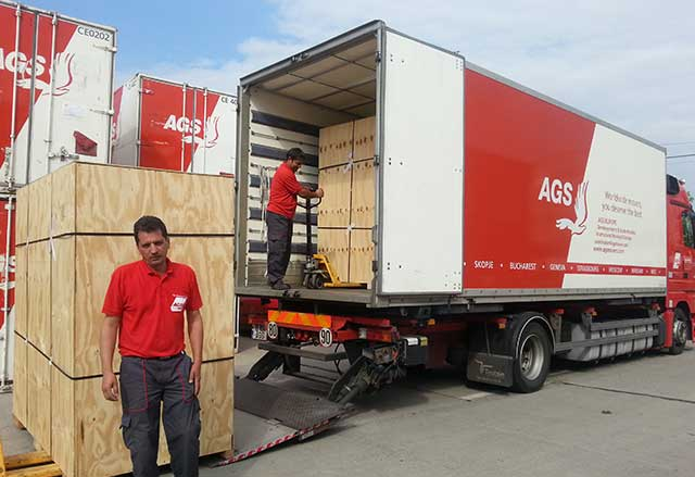 AGS Bucharest staff loading moving truck.