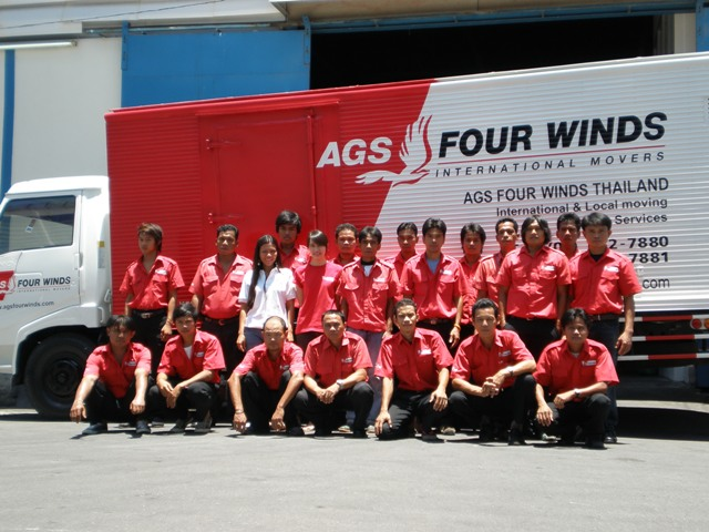AGS moving company staff in front of a moving truck.