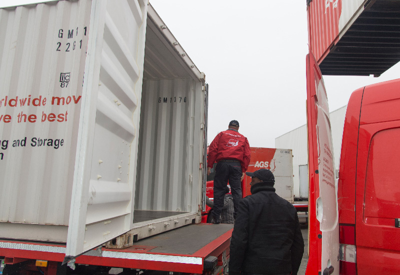 AGS Movers staff working outside loading a container