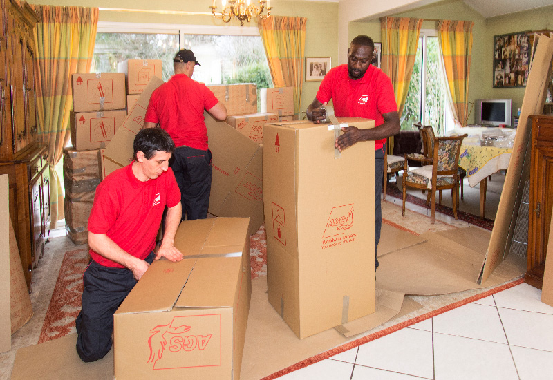 AGS furniture movers in Cape Town busy packing boxes