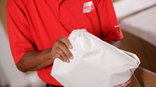 Movers and packers in Bangalore packing belongings.