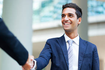 Man in suit handshaking with somebody