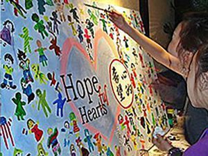 Kids painting hopeful hearts