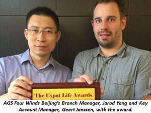 2 men posing with the expat life award