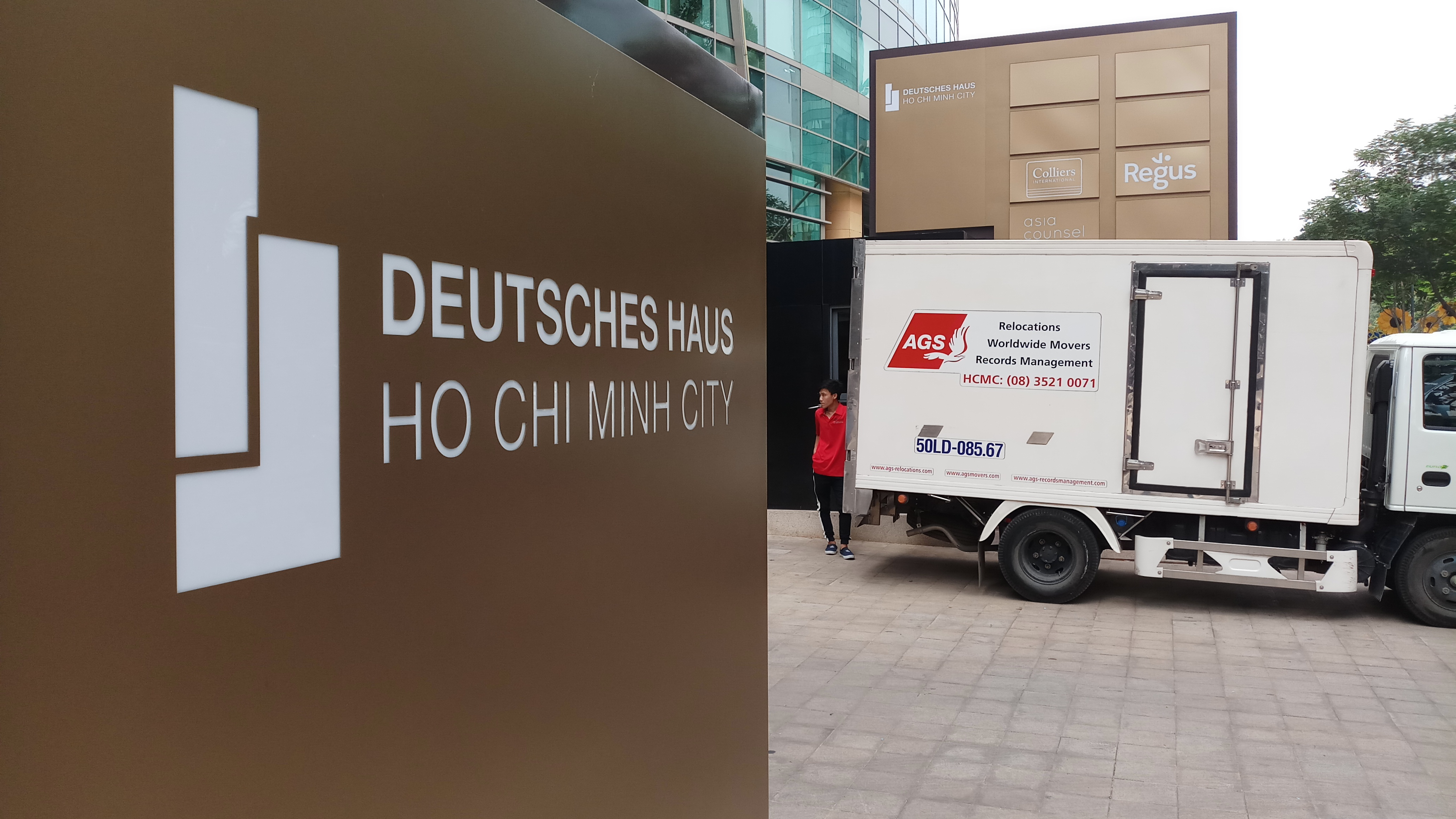 German consulate entrance and AGS Movers trailer.