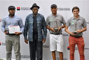 Golf tournament players with their awards.